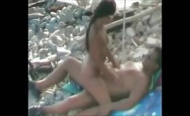 Two swingers couple on beach