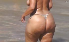 Topless Milf with thong bikini and huge ass