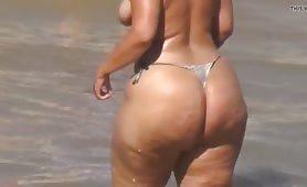 Topless Milf with thong bikini and huge ass