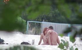 Horny couples fucking on beach