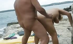 Old wife fucks on beach and takes a facial