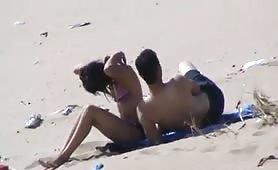 Kissing his hot GF on beach