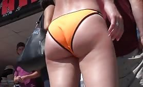 Bright orange bikini on round ass