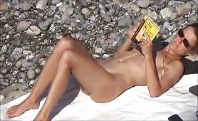 Beach nudist reading session