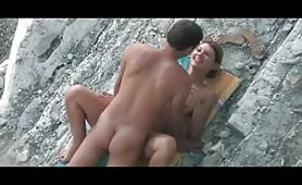 Missionary beach sex with cumshot