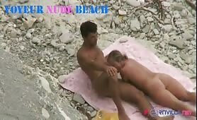 a naked couple on a nudist beach